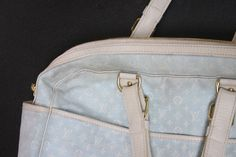 How to spot clean a leather purse: The best way to do this is using Distilled water, baby wash and microfiber towels. Heavily dilute the wash (a drop or two will do in 8-12 ounces of water) and mix the solution in a spray bottle. Never spray any cleaning product (even watered down) straight onto your leather bag; rather, spray the solution onto your towel , then gently wipe the bag.  It works wonders!