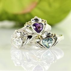 The heart and the hands: A Special Claddagh Ring Design. A bespoke Claddagh engagement ring of silver, featuring a facet cut amethyst heart held by the loving hands of friendship and crowned by loyalty. I find the original design somewhat unbalanced and have added to it by filling out the gap between crown and hands with lively bubbles of 18k gold. Have your very own combination of gold, silver and gems created just for you by mailing me!