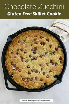 This Chocolate Zucchini Gluten Free Skillet Cookie is a healthier dessert made with almond flour, coconut oil, freshly grated zucchini, blueberries, and chocolate chips. It's the perfect dessert recipe for sharing! #skilletcookie #zucchini #chocolate
