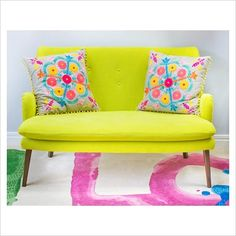 GAP Interiors - Embroidered cushions on Designers Guild sofa - Picture library specialising in Interiors, Lifestyle & Homes