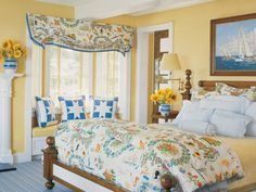 Master bedroom features Covington linen on walls. DBD fabric for Lee Jofa on comforter and shades. Carpet from DBD collection for Stark. Pillows of antique quilt pieces. Bed and nightstand by DBD. Painting by William Bishop. Schweitzer linens. Ann Morris sconce.