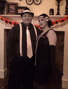 greyscale black and white couples halloween costume 1920s old photograph or silent film stars