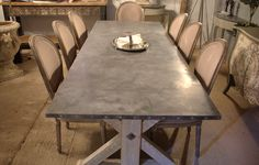 Zinc top Union base dining table, made to order. Handmade in England. Made with reclaimed timber. Bespoke table for your unique space.
