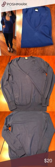 "J. Crew v-neck sweater in blue J. Crew v-neck sweater in blue, size XS. This lightweight sweater is in good pre-loved condition. There is a deodorant stain (small) towards the bottom as pictured and the neckline is somewhat faded in spots, also as pictured.  This 100% cotton sweater will make a great addition to your closet once this is brought to the dry cleaner. Approx. measurements when laid flat: 16"" pit to pit, 23"" shoulder to hem, 22"" sleeve. J. Crew Sweaters V-Necks"