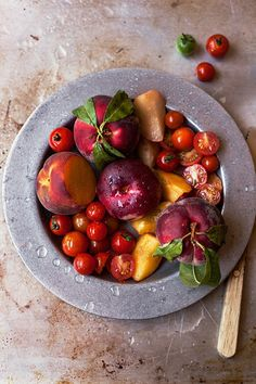 Peaches and Tomatoes | add balsamic vinegar, basil and you have the best caprese like salad..