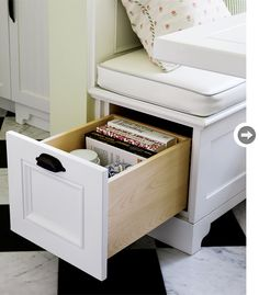 Hide & seekA drawer built into the end of a banquette turns previously unused space into a handy storage unit for cookbooks and occasional dishware.