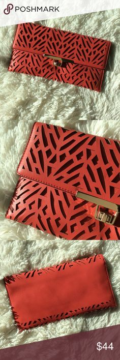❣️Red Laser Cut Clutch ❣️ Tosca laser cut clutch purse with detachable gold tone link strap. Man made materials. Tosca Bags Clutches & Wristlets