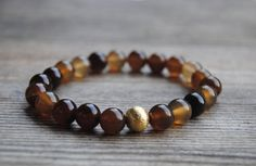 brown agate bracelet, stackable yoga bracelet, stretch bracelet, mala bracelet, buddhist prayer beads, healing bracelet  This bracelet is made with 8 mm brown agate natural gemstone beads and gold brushed bead.  It is strung on a strong and durable jewelry elastic.  Wear it throughout the day for the healing power of the stones, use for meditation, as a reminder of good things or simply as a unique piece of jewelry.  It looks great by itself but is also perfect for stacking.   ->Size…