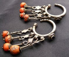 Africa | Old Berber earrings from Morocco | Silver coral and glass | Early 20th century.