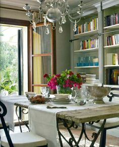 library / dining room combo. Rustic table. French doors. Table runners sideways.
