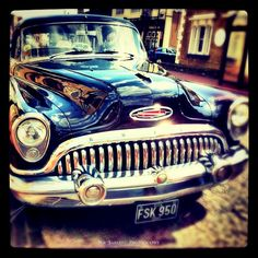 Drive Time by Nik Sargent on 500px http://500px.com/photo/4499673 It's a Buick. I love old American cars. Look at that grill! That's art.