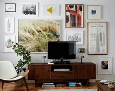 A modern, sleek TV gallery wall with an eclectic mix of artwork Home Living Room, Apartment Living, Living Room Decor, Living Spaces, Dining Room, Apartment Therapy, York Apartment, Living Room Inspiration, Home Decor Inspiration