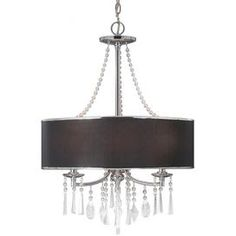 """Bring chic style to your living room, master suite, or foyer with this elegant chandelier, showcasing a drum shade and beautiful crystal drops.    Product: ChandelierConstruction Material: Metal, fabric and crystal glassColor: Tuxedo and silverFeatures: Beaded crystal dropsDrum shade UL and CUL listed for dry locations 72"""" Chain length 120"""" Wire length   Accommodates: (3) 60 Watt E12 incandescent candelabra base bulbs - not includedDimensions: 29"""" H x 21"""" DiameterAssembly: ..."""
