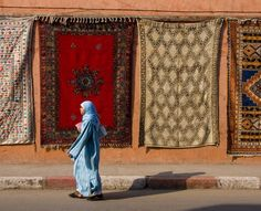 Intricately embroidered carpets line the streets with colour in Marrakech, Morocco.