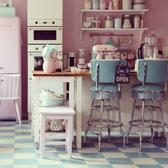 I LOVE the style of this kitchen/cafe. It has a 1950's theme with cute blue and…
