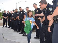 Palm Springs police escort fallen officer's daughter on first day at school since shooting