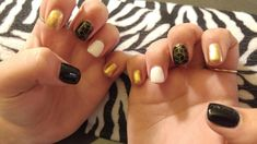 Geometic nail design!  Acrylic nails with stamped nail art and gel top coat.