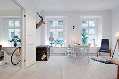 bleached white wood floors, wider planks. These floors almost look unfinished.