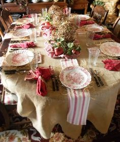 Christmas table details...use a fabric piece under each place setting when the table cloth is neutral.