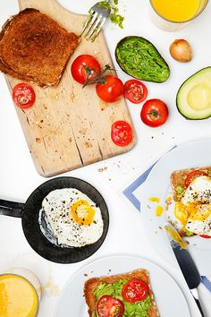 Slice the tomato and layer onto the avocado. Top with fried egg. Simple and delicious. Enjoy!