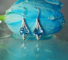 Blue Topaz Dangle Sterling Earrings
