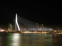 """Spanning over the Nieuwe Maas River, Erasmus Bridge is a beautiful cable-stayed bridge, which links the northern and southern halves of Rotterdam (Netherlands). Nicknamed """"The Swan"""", it was completed in 1996. Photo via Reinier on Flickr."""