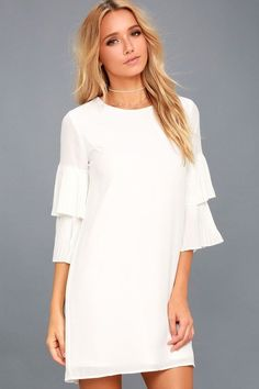 Be a fashion influencer in the Move and Shake White Shift Dress! Lovely chiffon falls from a rounded neckline, into fun three-quarter sleeves that boast tiers of fluttering pleats. Breezy shift skirt and back keyhole with top button.