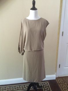 Lanvin Taupe Asymmetrical Cotton And Silk Sz 38 Eu/8 Us Dress. Free shipping and guaranteed authenticity on Lanvin Taupe Asymmetrical Cotton And Silk Sz 38 Eu/8 Us Dress at Tradesy. LANVIN Asymmetrical  Cotton and Silk Taupe Dress S...