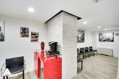 Black, White and Red Waiting Room. Dental Office Design by Arminco Inc.