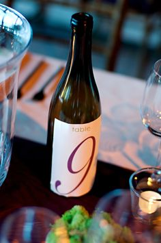Wine bottles for table numbers...maybe a red, white, and champagne bottle for each table?