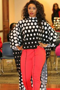 One Of A Kind Cape and red striped pants worn by this model and sold by #TwinFashion. This great look makes a flawless outfit and confidence to match. #PolkaDotCape #ColorMob #RobinandRoberta