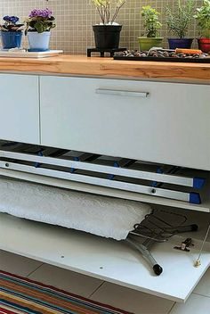 Home for ironing board - very creative! House, Apartment Storage, Home N Decor, Kitchen Decor, Cool Apartments, Laundry Room Design, Lavanderia, Long House, Kitchen Design