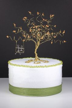 How cute would this look atop your wedding cake - a tiny bride and groom swinging on a tree of life - as they begin their new life together. What could be more perfect?  This sculpture would also make such a unique anniversary gift for your favorite couple!