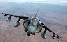 U.S. Marine Corps Capt. Jonathan Lewenthal and Capt. Eric Scheibe, AV-8B Harrier pilots with Marine Attack Squadron (VMA) 231, Marine Aircraft Group 14, 3rd Marine Aircraft Wing (Forward), fly over southern Helmand province, Afghanistan after conducting an aerial refuel on Dec. 6, 2012. VMA-231 deployed to Afghanistan to provide close air support for counter-insurgency operations. (U.S. Marine Corps photo by Cpl. Gregory Moore/Released)