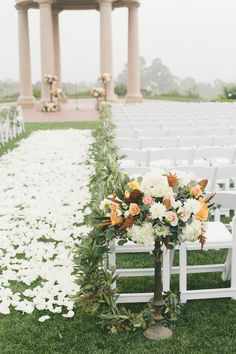 THICK carpet of rose petals for wedding ceremony. See  more of the wedding here: http://www.StyleMePretty.com/california-weddings/2014/05/14/classic-elegant-pelican-hill-resort-wedding/ Photography: One Love Photo - onelove-photo.com