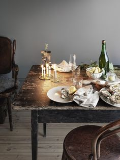 rustic table and chairs, white dishes. Inexpensive but keeping it consistently rustic is as charming as can be!