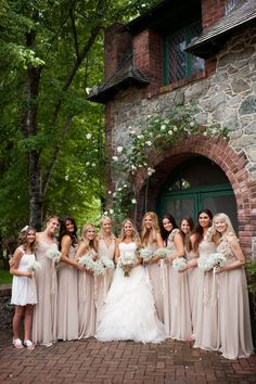Neutral & champagne dresses. Love the bouquets!!!