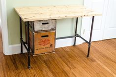 A desk made out of reclaimed lumber, used black pipes, antique soda crates, and recycled whey protein finish. The Clueless Woodwright: A Used Desk?