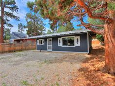 SOLD on 4/4/2014! COZY CABIN ON A DOUBLE LOT CLOSE TO PARK & THE NATIONAL FOREST. COMPLETELY REMODELED IN 2011. KITCHEN HAS HICKORY CABINETS & CUSTOM GRANITE COUNTER TOPS, TOP OF THE LINE STAINLESS STEEL GE APPLIANCES & OIL RUBBED BRONZE FAUCET. NEW GAS FP W/ SLATE TILE.BEAUTIFUL T&G PINE CEILINGS, DUAL PANE WINDOWS AND IT COMES FURNISHED. To view the latest best buy homes for sale in Big Bear. Click here: http://www.bigbearcabins4sale.com/featuredlistings/