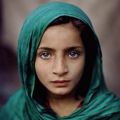 Photo taken by @stevemccurryofficial // I photographed this young girl in Peshawar, Pakistan. Her family fled Afghanistan during the civil war, and joined tens of thousands of other refugees in and around that city.  Her serene gaze belies their grueling existence living in a tent in a refugee camp.