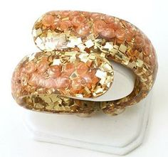 lucite bypass clamper bracelet with gold foil and orange seashell inclusions