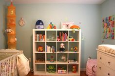 This is what the Ikea Expedit bookcase would look like in babys room - ours is black.