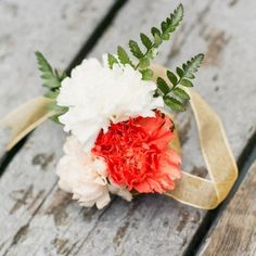 Make your own DIY wrist corsage using this easy tutorial. I used pretty carnations, ferns and gold ribbon to complete the package.