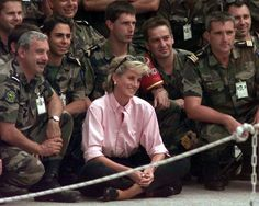 Princess Diana with a group of soldiers.
