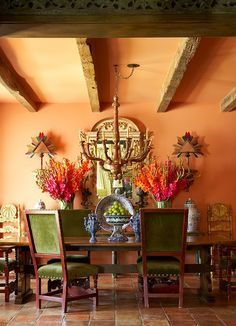Green chairs, table and orange walls.