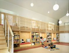 GraceChurch School Library nyc, CWB Architects: reading bays downstairs, window seats upstairs