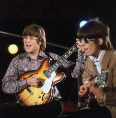 Beatles John Lennon and George Harrison during the Abbey Road session to record Paperback Writer and Rain, April 1966.