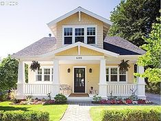 pale yellow/cream body, white trim and white painted porches, dark front door by patrice