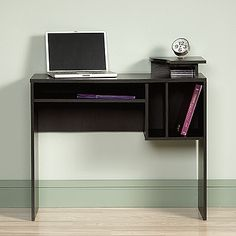 Elevated, contoured top. Divided open storage. Cord management. Bourbon Oak finish.