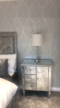 The Ariana Wave Wallpaper in Silver & White brought to you by I Love Wallpaper.  A Stunning and Unique pattern that enhances Luxury throughout every room.  For more colours and similar designs visit ilovewallpaper.co.uk #ilovewallpaper #homedecor #interiordesign #wall